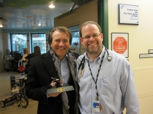 Trike Presentation On January 27, 2011, Robert Herjavec from Dragon's Den and Shark Tank went to SickKids Hospital to present the trike that he won at the Fishhead Benefit for Lonny's Smile to the Cardiac Unit Playroom